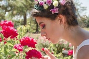 raise your vibration woman smelling roses